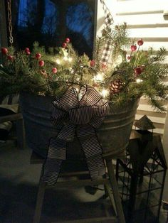 Easy Christmas porch decor idea: fill any metal or wood bucket or wicker basket with gathered twigs, branches, evergreens, ornaments,etc. then pile on a strand of Christmas lights! Prim Christmas, Country Christmas, Winter Christmas, All Things Christmas, Christmas Planters, Christmas Lights, Winter Porch Decorations, Porch Decorating, Decorating Ideas