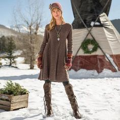 """WOODLAND HILLS DRESS - A shameless flatterer, this swing shape dress in a comforting, lambswool blend has radiating cables and a flared skirt for a classic silhouette. Lambswool/nylon. Hand wash. Imported. Exclusive. Sizes XS (2), S (4 to 6), M (8 to 10), L (12 to 14), XL (16). Approx. 37""""L."""