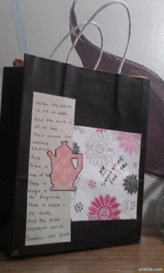 Recycled Paper Gift Bag adorned with strata paper, patterned paper with flower and teapot templates and quotes.
