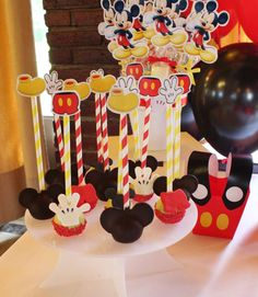 Cool cake pops at a Mickey Mouse baptism party! See more party ideas at CatchMyParty.com!