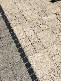 Aggragate pavers cut into interesting patterns but with a recycled brick border instead of this charcoal one
