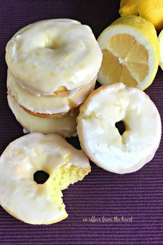 These fluffy lemon cake donuts, are baked to perfection, then dunked in a slight. - These fluffy lemon cake donuts, are baked to perfection, then dunked in a slightly tart lemon glaze - Baked Donut Recipes, Baked Doughnuts, Baking Recipes, Just Desserts, Delicious Desserts, Dessert Recipes, Yummy Food, Homemade Donuts, Homemade Breads
