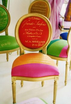 Tangerine and Raspberry sherbet chair with gold script. COLOR I luv et