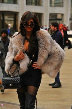 Chanel handbag and linx fur in the city