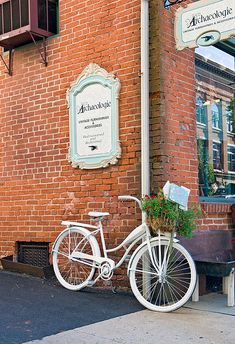 Store Front with bike  tHE WHITE BIKE i LIKE AGAIN.......Paint, Paint, Paint!!!!
