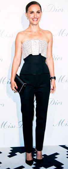 Natalie Portman in a strapless black, white Dior jumpsuit at the Miss Dior Exhibition Opening Cocktail event.