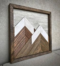 Bring the outdoors in with this reclaimed wood mountainscape! This piece features reclaimed cedar and local beetle kill blue pine from the Colorado Rocky Mountains. The mountain beetle imparts a blue pigment to the pine, which makes a wonderful sky for these reclaimed cedar