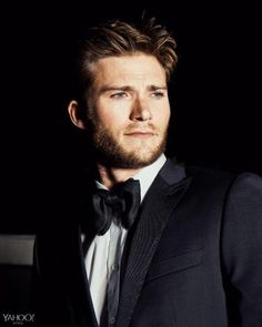 Scott Eastwood, channelling Dad Clint, flashes a cowboy stare in a BOSS tuxedo and dress shirt.