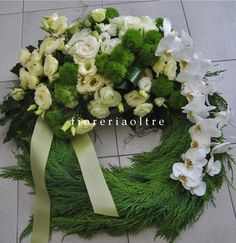 Fioreria Oltre/ In memoriam/ Sympathy wreath/  Funeral wreath/ Lisianthus, roses, carnations, phalaenopsis orchids, greenery  https://it.pinterest.com/fioreriaoltre/fioreria-oltre-in-loving-memory/