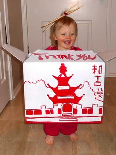 To-Go Box Baby: A cardboard box and paint was all it took to make this clever Chinese takeout baby costume. Chopsticks in the hair add a perfect finishing touch.