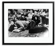 Jim Morrison Lies on Stage