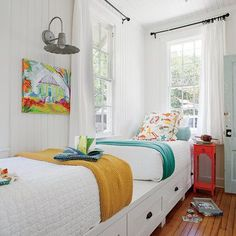 A simple, uncomplicated bunk room with plenty of built-in storage, natural light, and open space