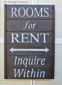 Rooms for Rent sign made from an old fruit drying rack.
