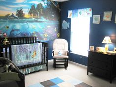 Under the Sea Ocean Themed Nursery with wall sized coral reef decal. Mural purchased with a Groupon discount from muralsyourway.com.