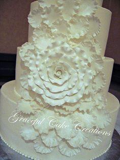 Elegant White Wedding Cake with a Rose Petal Cascade