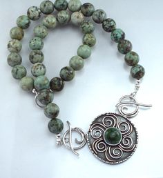 African turquoise with a large center pendant. Take the pendant off and use the additional clasp to wear just the beads alone. More choices on jlkjewelry.com Choices, African, Charmed, Turquoise, Beads, Pendant, Bracelets, How To Wear, Jewelry
