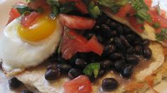 """Layered with black beans along with fresh salsa and shredded Monterey Jack cheese, this is a delicious version of the classic Spanish or Mexican """"rancher's eggs"""" dish."""