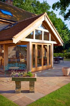 Cambridgeshire village home - a well lit dining area jutting out from the main building to optimize a wide view. Oak Framed Buildings, Timber Buildings, Oak Framed Extensions, House Extensions, Types Of Timber, Outdoor Gazebos, Dining Lighting, Timber Frame Homes, Energy Efficient Homes