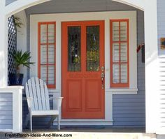 Charm charm charm. Orange front door and window on this adorable front porch. From Front-Porch-Ideas-and-More.com #frontdoor