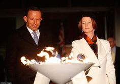 """Australian Prime Minister Julia Gillard and opposition Leader Tony Abbott jointly light a ceremonial beacon to mark the Queen's Diamond Jubilee at Parliament House in Canberra. (She refused to sing """"God Save The Queen""""! Beacon Lighting, Tony Abbott, Houses Of Parliament, Save The Queen, Rest Of The World, Light Up, Britain, Prime Minister, Politics"""