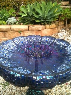 Copyright © Tanja Hawker  2012  Campbelltown City Council Art Show Entry  Upcycled Materials: Ceramic Tile 50 %Art Glass Mirror Cubic Zircons Amethyst Crystal Beads Stainless Steel Beads Stainless Steel Sink Strainer Birdbath  New Materials: Glass Tile %50 Art Glass Glass Gems Faceted Glass Beads Galvanised Fencing Wire Zinc Washers Charcoal Sanded Grout Glues and Waterproofing