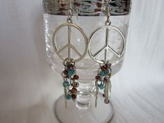 Silver Peace Sign Dangle Beads and Feathers Earrings. $15.00, via Etsy.