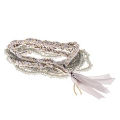 Get the #boho look by using neutral toned #jewelry. Five time wrap, made with silk cord, #gray beads, woven with delicate chain. 24 in. long. Button closure. * Marlee's Designs * #Boheme Collection Five Wrap Beaded Bracelet | Marlee's by Tappers | www.marleesstyle.com