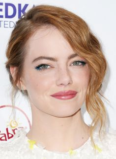 Emma Stone shows off her dewy complexion with electric blue eyeliner