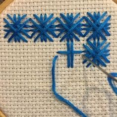 "I smile every time I say ""double cross"" stitch.  This stitch really requires you to follow the stitching pattern in order to keep it visually consistent if you are using it as a filler. It builds upon itself into a nice weave.  This stitch is 7 down and 7 across The order you go in is super important so follow along exactly Now I thought I would glam it up a bit so I started with just some upright cross stitches… then I added some filler lines… whatever feels right to you! Happy Sti..."