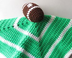 """This pattern contains instructions on how to crochet your very own Football Security Blanket. Finished measurements are 16 x 16"""". $5"""