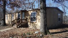 3 bedroom 2 bath double wide manufactured home offers open living dining kitchen area, newer laminate flooring, carpet, roof and windows. Recently painted and nice pantry off kitchen. Outside offers back covered patio, large detached shop with concrete floor and electric. All situated on nice 24.89 acres in Gatewood MO