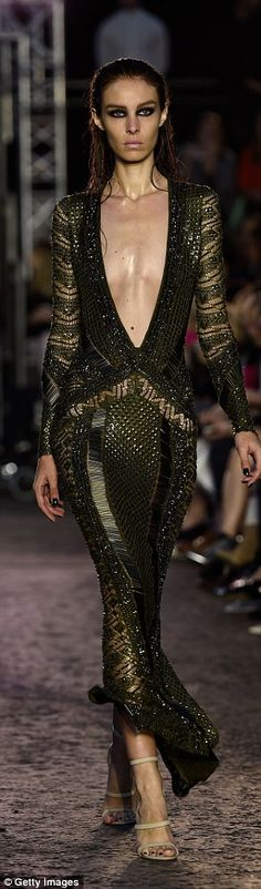 The designer, who is known and loved for his sparkly designs, went grunge today...