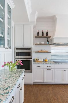 Laura U Interior Design   cottage kitchen with glass front upper cabinets and turquoise recycled glass countertops