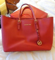 Michael Kors-please Santa bring me this red bag...I have been pretty good this year!
