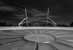 Space base... - It's the area of Athens Olympic stadium, where the 2004 games took place.  Calatrava's design is so recognizable to anyone in the city.  Lines, curves and shapes give food for thoughts...