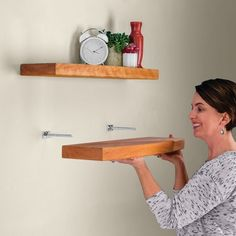 Simply bore the holes into the back of your shelf and slide it onto the supports!