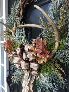 My creations :) Rustic fall or winter wreath with antlers in a grape vine wreath with Green pines.and deer ribbon bow Antler Wreath, Deer Antler Crafts, Antler Art, Craft Font, Holiday Wreaths, Holiday Decor, Deer Decor, Deer Horns Decor, Diy Weihnachten