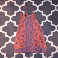 Pretty patterned flowy, light, orange dress Great condition, size small, pretty unique floral patterned dress with strappy details at top, color is mainly Orange with some teal white and blue detail, worn twice, wrinkly but can easily be ironed and look good as new, boutique brand, not UO, posting for views, make me an offer  Urban Outfitters Dresses