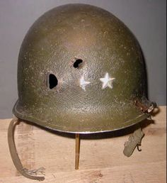The Helmet of WWII 3rd Armored Division Commander Major General Maurice Rose. The only General Officer of WWII to die in frontline combat (shot by a Panzer commander in his Jeep) and the highest ranking soldier in the US army of the Jewish faith. [500x548]