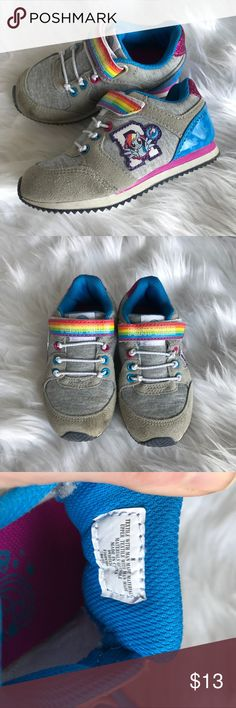 Girl's My Little Pony Tennis Shoes Girl's My Little Pony grey tennis shoes. Velcro closure. Grey with rainbow accents and sparkles. Some wear on the front otherwise in good condition. Size 8.  Always bundle with other items for best deal. My Little Pony Shoes Sneakers