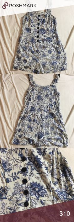 """Forever 21 Boutiques floral romper Cute blue floral romper by Forever 21 Boutiques.  Small belt loop, but missing belt.  Has pockets.  Size S  Measures 16"""" pit to pit.  Shoulder strap is 6"""".  Length is 28"""" from shoulder.  Inseam 2"""".  Measures 14"""" across at waist.  All measurements laying flat. Forever 21 Other"""