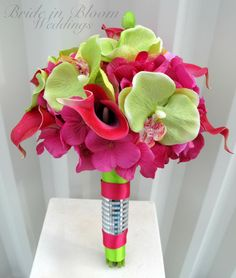 Wedding Bouquet hot pink calla lily lime with orchids.  dont like the stem wrap. love the flowers.  may have to tie in some black, pink and lime green ribbon into stems.