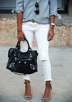 Blue and white stripped button up and white Jeans.