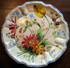Decorative Dishes - OLD Rustic Handpainted Made in Italy Daisy Tulip Flute Edge Plate, $19.99 (http://www.decorativedishes.net/old-rustic-handpainted-made-in-italy-daisy-tulip-flute-edge-plate/)
