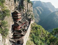 15 Astonishing Little-Known Destinations Worth Traveling To - Wahuang Palace - This mountainside Chinese palace is the biggest and earliest ancient building for offering sacrifice to Goddess Nvwa. It houses 135 rooms and over 130,000 characters of beautiful handwriting carved into the stone Chinese Architecture, Ancient Architecture, Places To Travel, Places To See, Travel Destinations, Places Around The World, Around The Worlds, Fairy Pools, Ancient Buildings