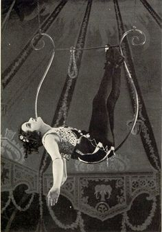 I wish the source said more!  Who was she?  What circus did she perform with?  Who made this wonderful lyra?  I am amused that it is double picked.  This must have been more of a static trapeze than a modern spinning act.