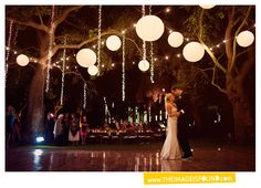 A romantically lit dance floor with #lanterns and #string #lights