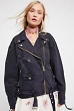 Oversized Denim Moto Jacket   Oversized denim moto jacket featuring front pockets with snap and zipper closures. * Front zipper closure * Belt buckle at the waist * Zipper accents on the sleeves