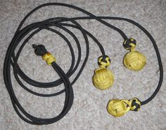 "This is a traditional large game bolo.  Two 30"" and one 36"" long cords.  I'm using a monkeyfist knot over two 7/8"" and one 5/8"" steelies.   Double diamond knots are just above the monkey fists and also connect the three.  Two yellow slider knots keep the cords from knoting when not in use."