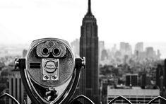 Black and white photos of building from new york city the largest city